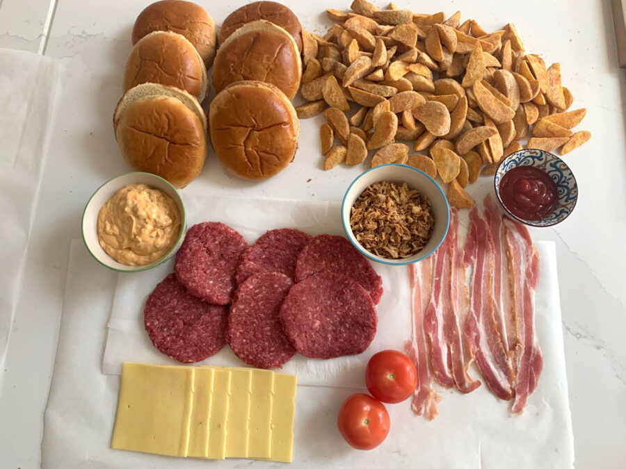 Build your own burgers, brioche buns, wedges, cheese, crispy bacon, tomato, special sauce